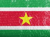 Surinamese flag painted on bubblewrap — Stock Photo