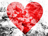 Red Heart symbol painted dirty and grungy paper — Stock Photo