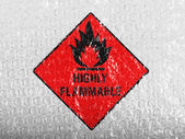 Highly flammable sign drawn on painted on bubblewrap — Stok fotoğraf