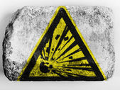 Explosive sign drawn on painted on brick — Stock Photo