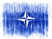 NATO symbol drawn on white background with colored crayons — Stock Photo