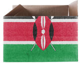 Kenya flag painted on carton box or package — Stock Photo
