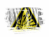 Explosive sign drawn on painted with watercolor on wet white paper — Stock Photo