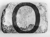 O letter painted on brick — Stock Photo