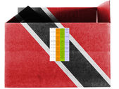 Trinidad and Tobago flag painted on carton box or package — Stock Photo
