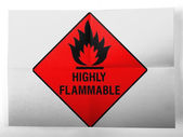 Highly flammable sign drawn on painted on simple paper sheet — Stock Photo