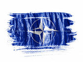 NATO symbol painted on painted with watercolor on wet white paper — Stock Photo