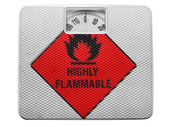Highly flammable sign drawn on painted on balance — Stock Photo