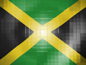 Jamaica flag on wavy plastic surface — Stock Photo