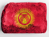 Kyrgyzstan flag painted on brick — Stock Photo