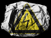 Electric shock sign painted on painted on crumpled paper on black background — Stock Photo