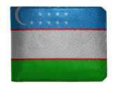 Uzbekistan flag painted on leather wallet painted on leather wallet — Stock Photo