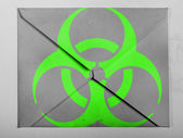 Biohazard sign painted on painted on grey envelope — Stock Photo