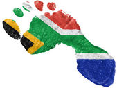 South African flag painted in a shape of footprint — Stock Photo