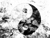 The Ying Yang sign painted dirty and grungy paper — Stockfoto
