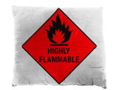 Highly flammable sign drawn on painted on pillow — Stok fotoğraf