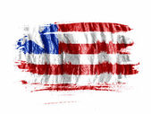 Liberia. Liberian flag painted with watercolor on wet white paper — Stock Photo