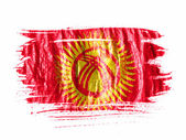 Kyrgyzstan flag painted with watercolor on wet white paper — Stock Photo