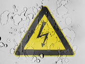 Electric shock sign painted on covered with water drops — Stok fotoğraf