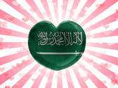 Saudi Arabia flag painted on glass heart on stripped background — Stock Photo