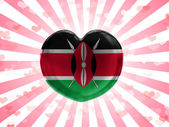 Kenya flag painted on glass heart on stripped background — Stock Photo