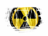 Nuclear radiation symbol painted on painted with watercolor on wet white paper — Stock Photo