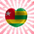 Togo flag painted on glass heart on stripped background — Stock Photo #23431704