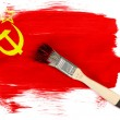 The USSR flag painted on  painted with brush over it - Stock Photo