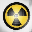 Stock Photo: Nuclear radiation symbol painted on on wavy plastic surface