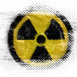 Stock Photo: Nuclear radiation symbol painted on on dotted surface