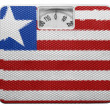 Stock Photo: Liberia. Liberiflag painted on balance