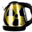 Nuclear radiation symbol painted on shiny metallic kettle — Stock Photo #23433324