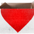 Red Heart symbol   painted on carton box or package - Stock Photo