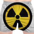 Nuclear radiation symbol painted on sport shirts — Stock Photo #23433640