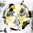 Stock Photo: Nuclear radiation symbol painted on painted on grunge wall