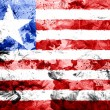 Stock Photo: Liberia. Liberiflag painted dirty and grungy paper