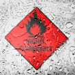 Stok fotoğraf: Highly flammable sign drawn on covered with water drops