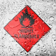 Stock Photo: Highly flammable sign drawn on covered with water drops