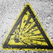 Explosive sign drawn on covered with water drops — Stock Photo #23437698