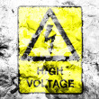 High voltage sign painted dirty and grungy paper — Stock Photo