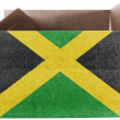 Jamaica flag  painted on carton box or package - Stok fotoğraf