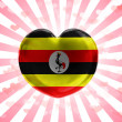 Uganda flag painted on glass heart on stripped background — Stock Photo #23438682