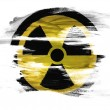 Nuclear radiation symbol painted on painted on white surface — Stock Photo #23439264