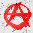 Stock Photo: Anarchy symbol painted n covered with water drops