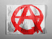 Anarchy symbol painted n painted on pills — Stock Photo