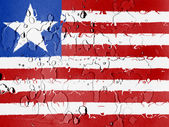 Liberia. Liberian flag covered with water drops — Stock Photo