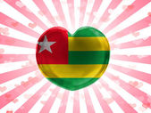 Togo flag painted on glass heart on stripped background — Stock Photo
