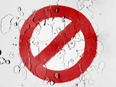 Forbidden sign painted on covered with water drops — Stock Photo