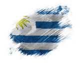 Uruguay flag painted with brush on white background — Stock Photo