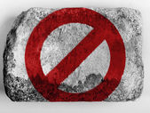 Forbidden sign painted on painted on brick — Stock Photo